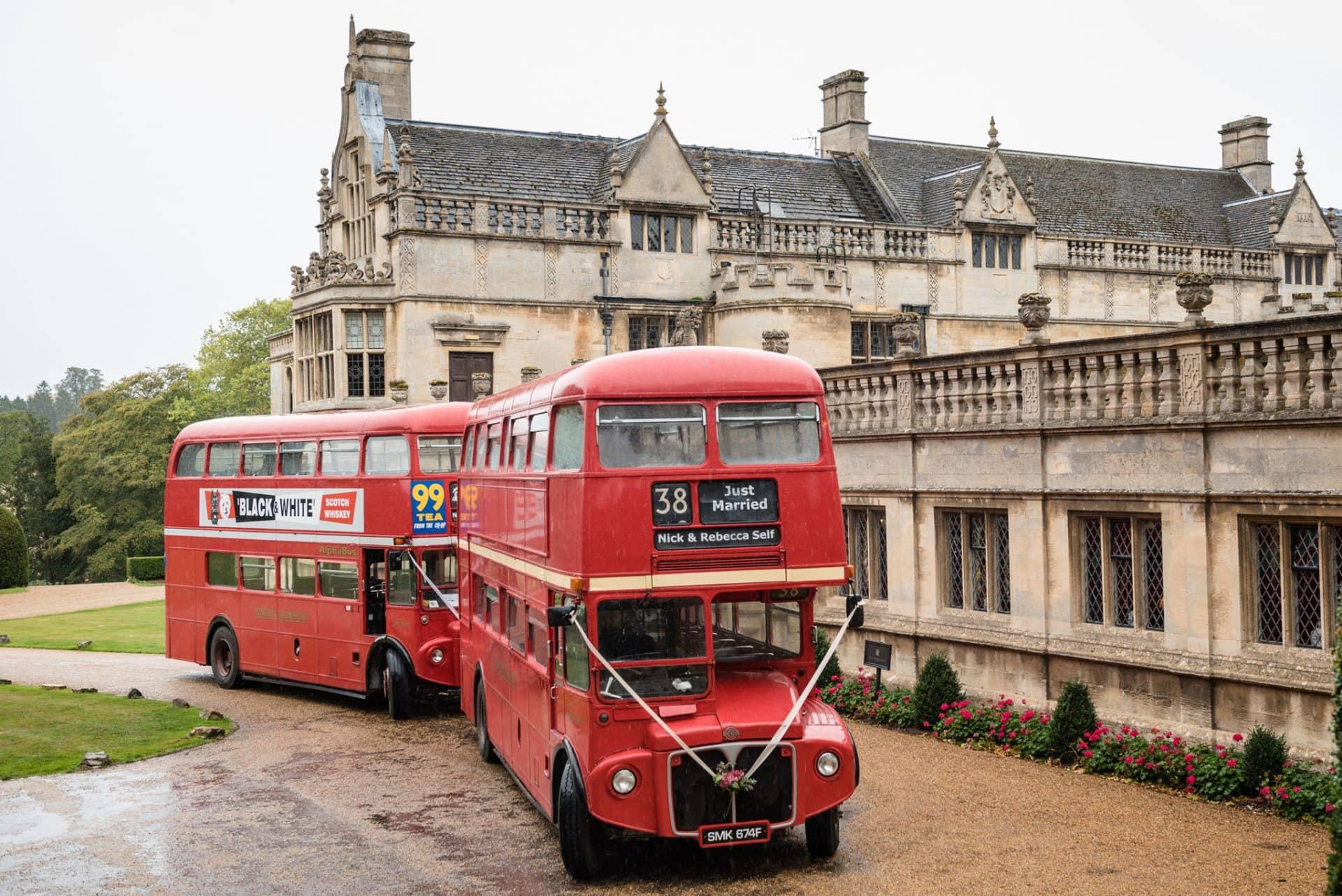 Red London bus at a wedding at Rushton Hall